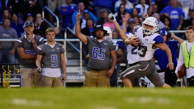 Dakota Wesleyan's Luke Loudenburg runs past defenders to score a touchdown against Dakota State in a game in 2016.