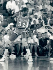 Pistons guard Joe Dumars defends Lakers guard Magic Johnson in a game at the Silverdome in 1988.