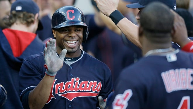 Indians centerfielder Rajai Davis is congratulated in the dugout after scoring during the third inning Friday at Comerica Park.