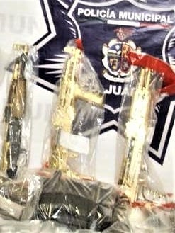 Gold-plated AK-47 rifles were among more than 40 firearms in a weapons cache in Juárez.