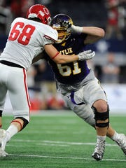 Wylie defensive lineman Kade Parmelly (61) pushes away Carthage offensive lineman Jesse Pierce (68) during the second quarter of Wylie's 31-17 loss in the Class 4A Div. I state championship game on Friday, Dec. 16, 2016, at AT&T Stadium in Arlington.