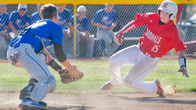 Mesilla Valley Christian School's catcher Zach Castillo waits for Cardinals Logan Gaskins at home plate for the easy tag out Wednesday evening at Apodaca Park.