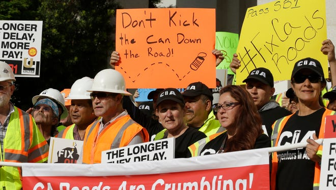 Supporters of a plan for a $5 billion-a-year tax and fee road repair measure rally at the Capitol on Wednesday in Sacramento.