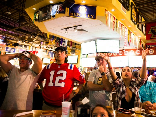 Patriots fans react to a play during Super Bowl LII against the Philadelphia Eagles on Sunday, February 4, 2018 at Foxboro Sports Tavern in Naples.