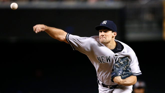 New York Yankees' Nathan Eovaldi throws a pitch against the Arizona Diamondbacks during the first inning of a baseball game Wednesday, May 18, 2016, in Phoenix.