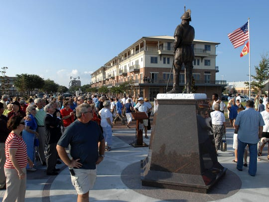 Scores of people check out the life-size bronze statue of Spanish explorer Don Tristan de Luna after its unveiling in 2009 at Plaza de Luna to celebrate the 450th anniversary of the founding of Pensacola.