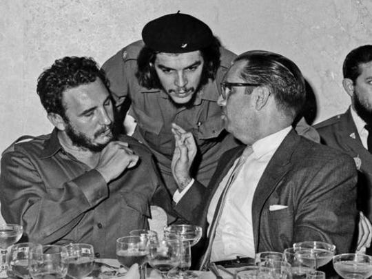 """FILE - In this 1960 file photo, Cuba's revolutionary hero Ernesto """"Che"""" Guevara, center, Cuba's leader Fidel Castro, left, and Cuba's President Osvaldo Dorticos, right, attend a reception in an unknown location in Cuba. Castro has died at age 90. President Raul Castro said on state television that his older brother died at 10:29 p.m. Friday, Nov. 25, 2016."""