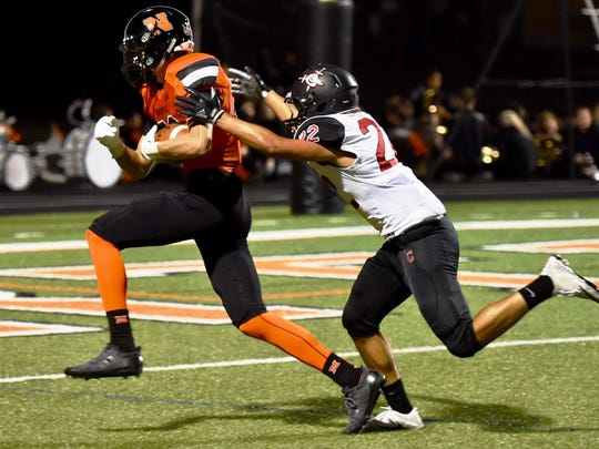 Northville's Ben Schmidt (left) hauls in a 34-yard