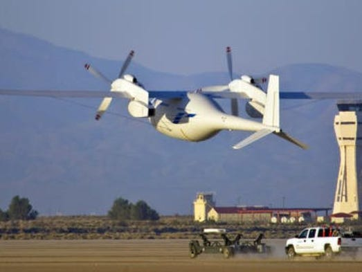 In this June 1, 2012, photo provided by Boeing, the new Boeing Phantom Eye unmanned drone, designed to stay airborne for days, takes off on its first autonomous flight at the NASA Dryden Flight Research Center at Edwards Air Force Base, Calif. The Federal Aviation Administration said Tuesday it has granted the first permission for commercial drone flights over land, the latest effort by the agency to show it is loosening restrictions on commercial uses of the unmanned aircraft.