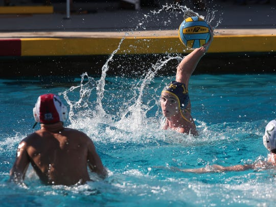 La Quinta's Will Alwine shoots and scores against Bonita during the CIF first round water polo match on Wednesday in La Quinta.