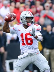 Ohio State's J.T. Barrett,  one of the nation's most efficient passers, threw four interceptions at Iowa,  including a pick-6.
