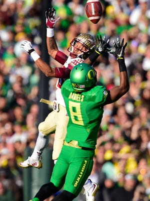 Oregon defensive back Reggie Daniels defends a pass against Florida State wide receiver Rashad Greene in the Rose Bowl.