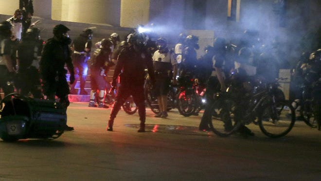 Columbus police on several occasions used pepper spray to disperse protesters, as seen here on the Ohio Statehouse grounds on the night of May 28, 2020.