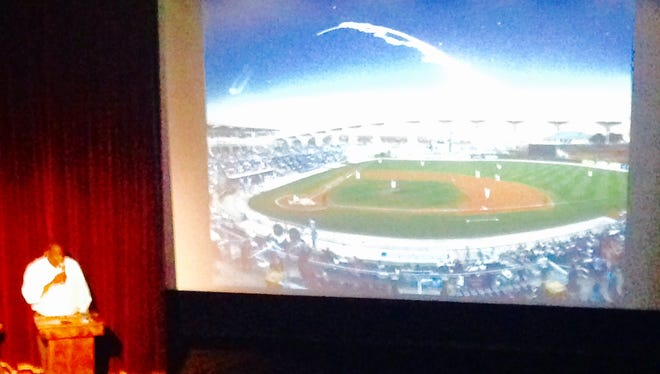 Brevard County Commission Robin Fisher makes a presentation on his proposal for a $25 million downtown Titusville stadium and events center. More than 200 people attended the presentation last month at the Titusville Playhouse.