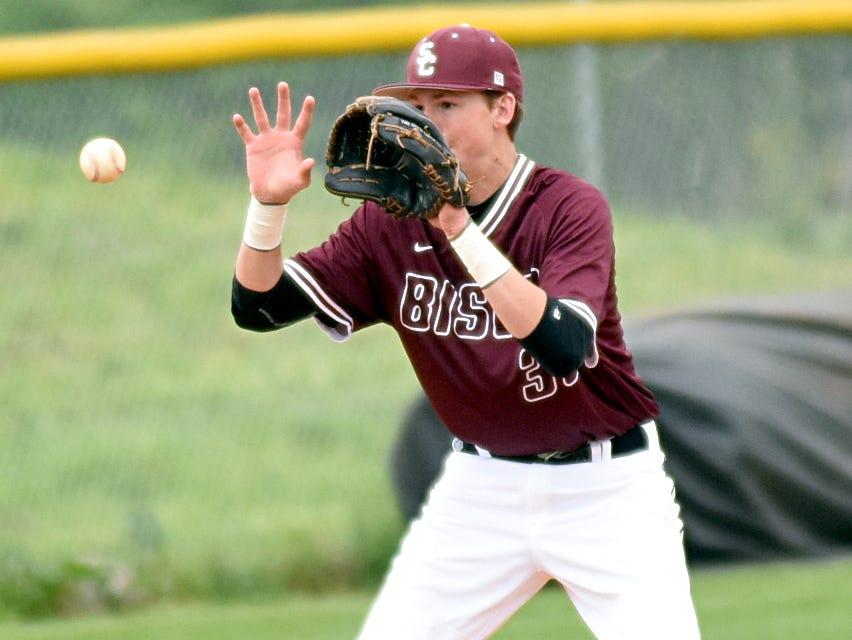 Station Camp High senior third baseman Brad Deason fields a fifth-inning ground ball.