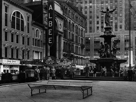 The RKO Albee Theater, overlooking Fountain Square in 1949, was the most palatial of the city's movie houses, featuring a five-story-tall cavernous auditorium. The Neoclassical marble arch was saved when the Albee was torn down in 1977, and was added to the Fifth Street side of the Duke Energy Convention Center.