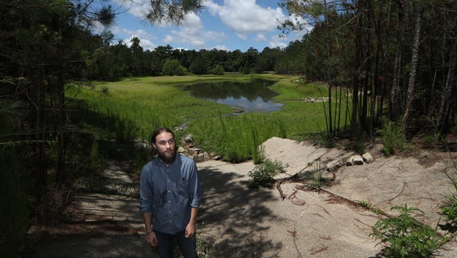 Local resident and biologist Alex Drew is hoping the city will scale back the transformation of the natural landscape, located at Fred George and Mission Roads, from the city's plan to turn in to a park with playgrounds, trails, picnic pavilions, athletic fields and courts for basketball, disc golf, sand volleyball and pickleball.
