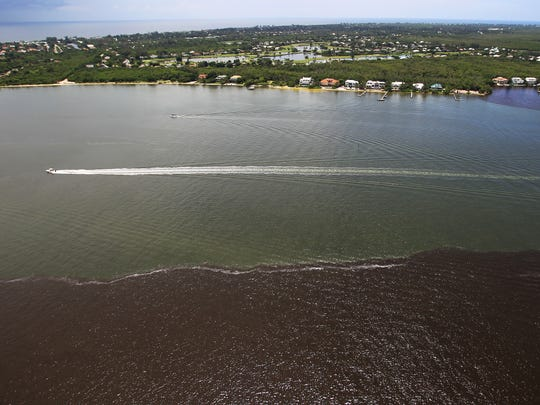 Water from the Caloosahatchee River, brown, and the Gulf of Mexico, blue, meet near Sanibel Island after a combination of Lake Okeechobee releases and local stormwater runoff.