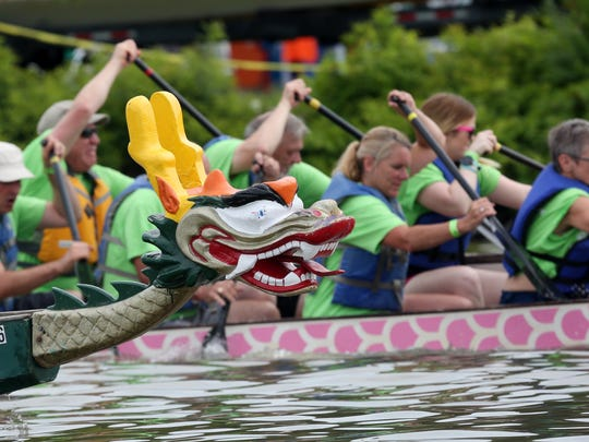 A pair of Dragon Boats head to the finish line during the 4th Annual Dutchess Dragon Boat Race and Festival on the Hudson River in Poughkeepsie July 22, 2017. This year the event raised money for Habitat for Humanity of Dutchess County.