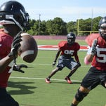 Palm Bay High football players run drills during practice.