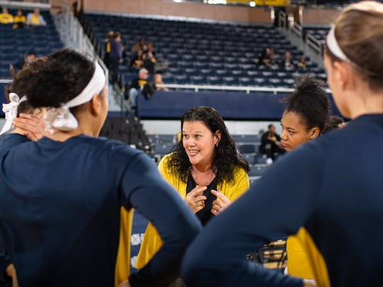 Melanie Moore, center, was introduced Friday as the new women's basketball head coach at Xavier University.