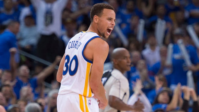 Golden State Warriors guard Stephen Curry (30) celebrates during the third quarter against the New Orleans Pelicans at Oracle Arena.