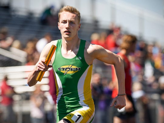 Sauk Rapids' Mitch Peterson take the baton on the last leg of the 4 x 400 meter relay during the Sauk Rapids Mega Meet Saturday, May 6, in Sauk Rapids.