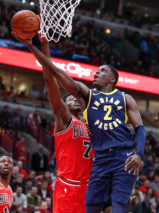 Indiana Pacers guard Darren Collison (2) goes to the basket against Chicago Bulls guard Justin Holiday (7) during the first half of an NBA basketball game, Friday, Dec. 29, 2017, in Chicago. (AP Photo/Kamil Krzaczynski)