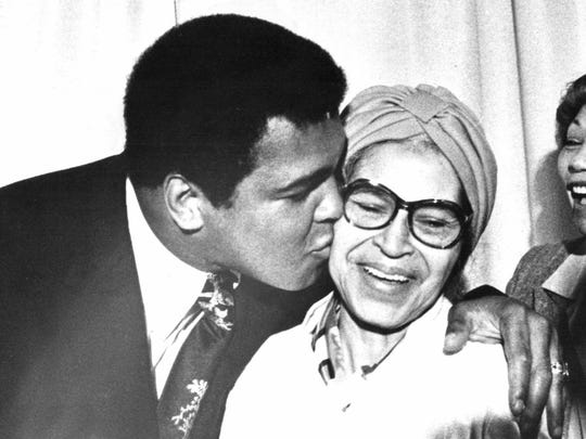 Muhammad Ali greets civil rights leader Rosa Parks in 1979. She led the Montgomery, Ala., bus boycott.
