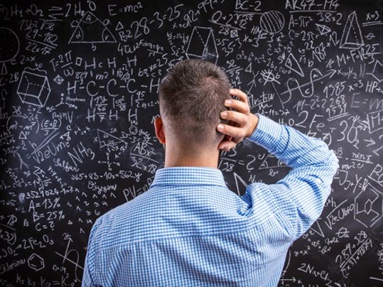 confused-man-staring-at-blackboard-with-complicated-equations-formulas-math_large.jpg