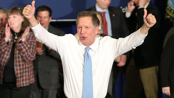 John Kasich waves to the crowd after speaking at a
