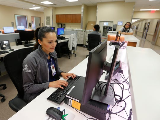 Registered nurse Veronica Hernandez works Wednesday