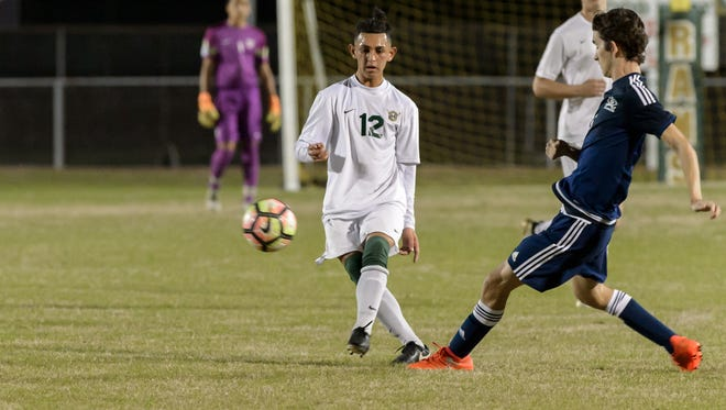Carlos Hernandez drives the ball down field as Acadiana takes on Barbe. Wednesday, Feb. 8, 2017.