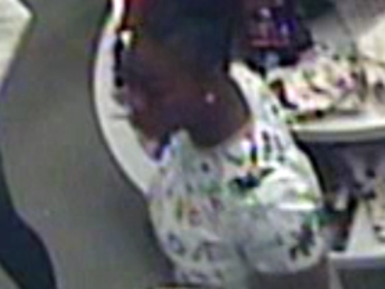 One of three women suspected of taking goods from area stores without paying for them was caught on one store's security camera.