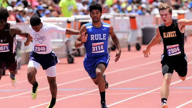 Rule's Chase Thompson reaches for the finish line in the Class 1A boys 100-meter dash at the UIL State Track and Field Championships at the University of Texas' Mike A. Myers Stadium in Austin on Saturday. Thompson won the event with a time of 10.88 seconds.