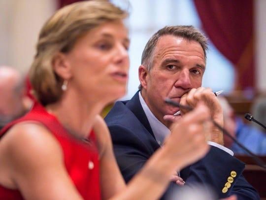 "Republican candidate Lt. Gov. Phil Scott, right, listens as Democrat Sue Minter speaks during a gubernatorial debate at the Statehouse in Montpelier on Thursday, September 22, 2016. Bill ""Spaceman"" Lee of the Liberty Union party also participated."