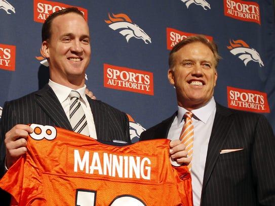 Denver Broncos quarterback Peyton Manning and John