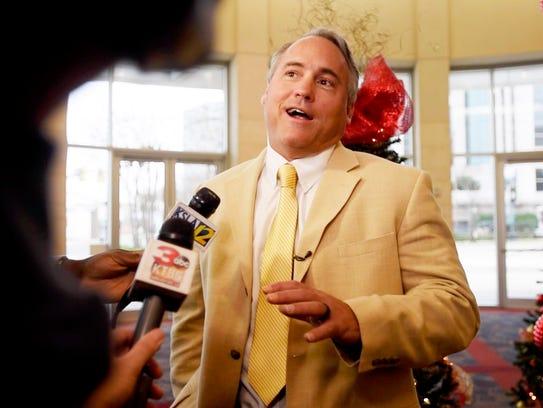 Southern Miss coach Jay Hopson talks to the media Saturday