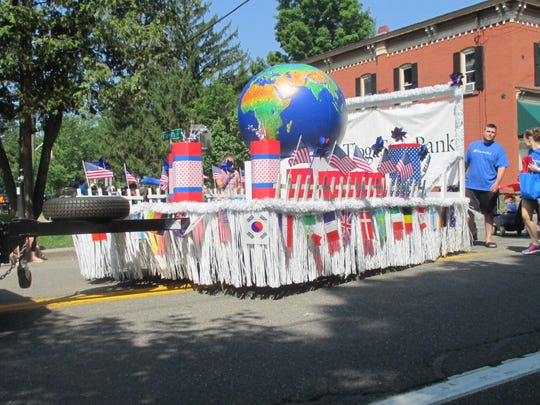 """This Tioga State Bank float won first place in the Spencer Picnic 2016 parade. The theme was """"Nations Around the World"""" and the float included the words e pluribus unum from our nation's coinage."""
