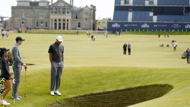 Tiger Woods looks into a bunker on the 18th hole at St Andrews, Scotland,  June 11, 2015.