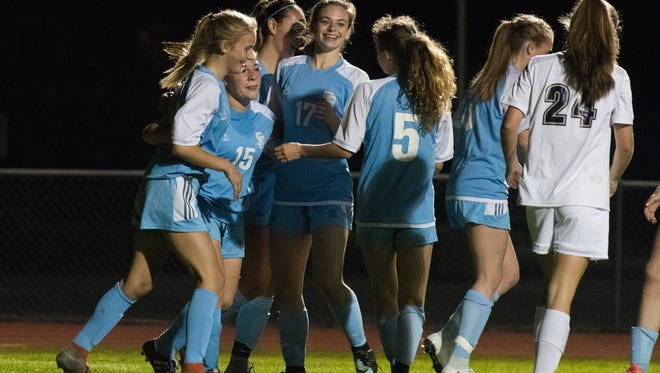 South Burlington celebrates a goal during the girls soccer game between the South Burlington Wolves and the Essex Hornets at Essex High School on Saturday.