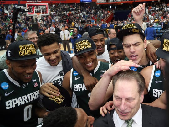 Michigan State head coach Tom Izzo and team after