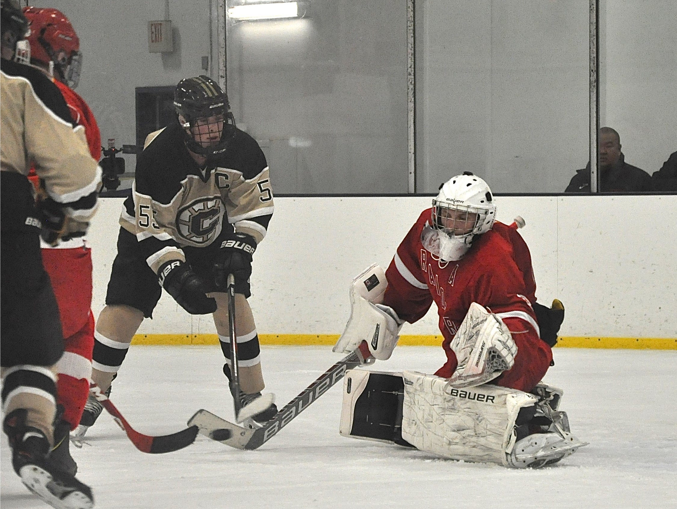 Kenny Hoppe makes one of his 36 saves with Clarkstown's Luke Myers (55) on the doorstep.