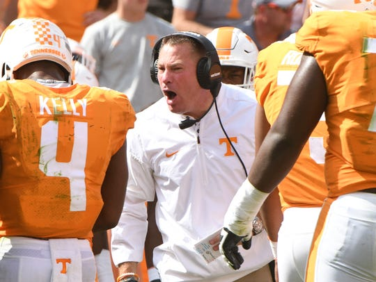 Tennessee Head Coach Butch Jones yells to his players