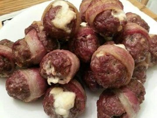 Don't miss Bacon Babes'Armadillo Eggs. Feta and cream cheese are stuffed into fresh jalapenos wrapped in ground bison and then bacon. They come out hot and creamy inside, crunchy outside.