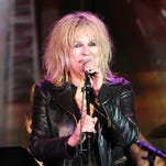 In this April 23, 2014 file photo, Lucinda Williams performs on stage at the 31st Annual ASCAP Pop Music Awards in Los Angeles.