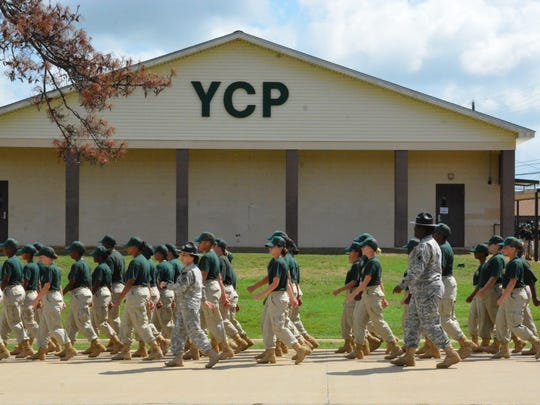 Female cadets of the Youth Challenge Program march Sunday toward the Parade Field for Family Day activities at Camp Beauregard.