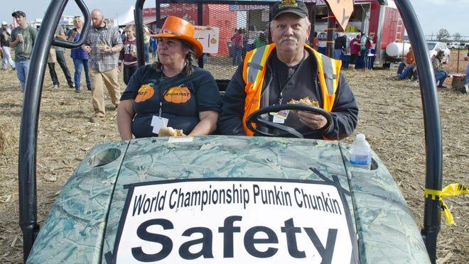 Bill and Dawn Thompson, Punkin Chunkin volunteers, sit in an ATV during the 2013 Punkin Chunkin event in Bridgeville.