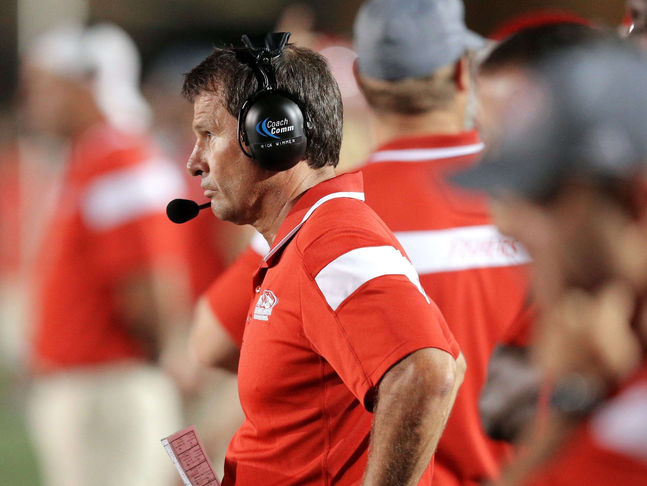 Fishers head coach Rick Wimmer, shown here against Pike in 2014, was placed on administrative leave.