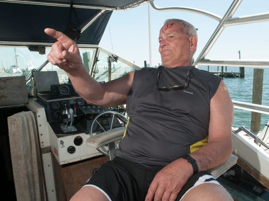 Wayne Benson talks on Tuesday, May 2, 2017, about the injuries he suffered when his boat broke free from its moorings at Southwind Marina during a storm on Sunday, April 30, 2017. Benson's neighbor, Eric Zupo, rescued him from the water.